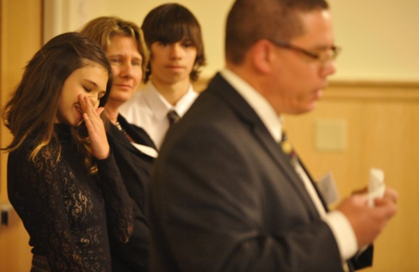 Nicole Maines (left), 14, tears up as her father, Wayne Maines, delivers a stirring address about his family's love and fortitude while helping Nicole with her life as a transgender youth. The family received the 2011 ACLU of Maine's Roger Baldwin Award for their courage and perseverance in helping to defeat the recent anti-transgender legislation in the Maine State House. Next to Nicole are her mother, Kelly Maines, and her twin brother, Jonas.