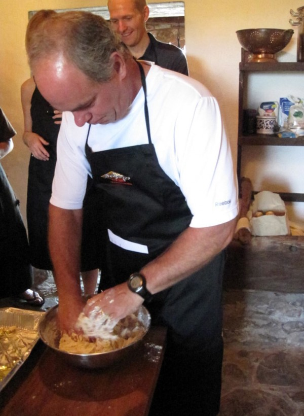 Il Campo cooking student Dave Smith gets some hands-on time kneadng dough for focaccia at Il Campo Cucina Cooking School.