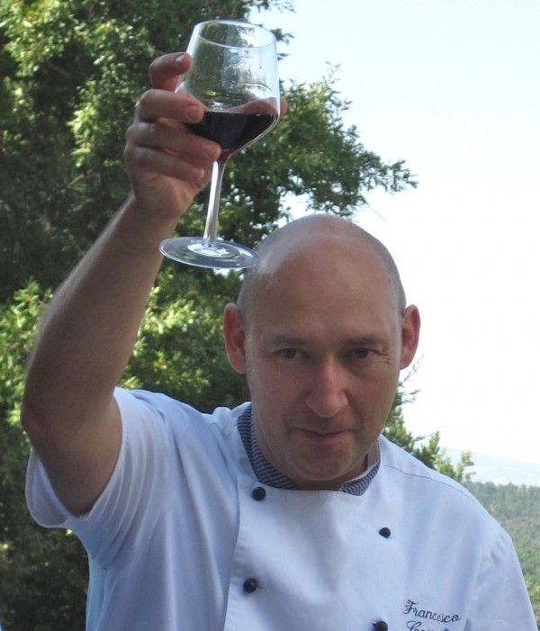 Chef Francesco Costagli raises a glass in toast following his morning of teaching 11 cyclists the finer arts of Tuscan cooking at Il Campo Cooking School.