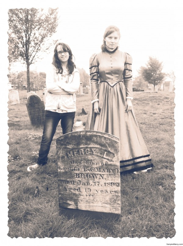 """Emily Lunt of Falmouth dressed as undead Mercy Brown, accused of being a vampire in the 1890s, poses with Egypt Pooler of Portland, at the launch party for """"Mercy: The Last New England Vampire"""" by Sarah L. Thomson on Oct. 1 at Eastern Cemetery in Portland."""