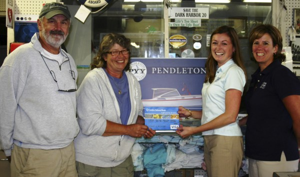 Pictured here from left to right are Stanley Pendleton, owner of Pendleton Yacht Yard; Jayne Barrett, Pendleton Yacht Yard employee and winner of Camden National's Online Services Drawing; Camden National Bank Assistant Vice President Jody Landrith; and Camden National Bank Vice President Leslie Eaton.