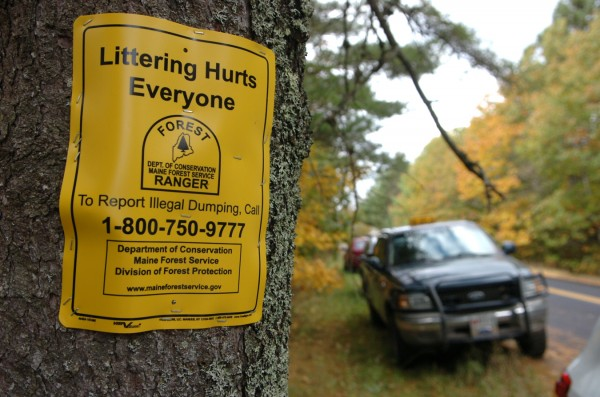 Jerry Parsons, a forest ranger with the Maine Department of Conservation, posted this service announcement at a clean-up site off Kenduskeag Road in Kenduskeag as well as other sites where illegally dumped trash was removed Saturday, Oct. 15, 2011, as part of Landowners Appreciation Cleanup Day.