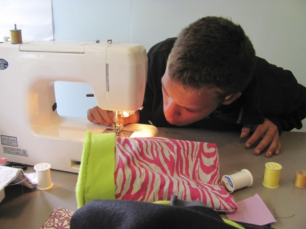 Adam Flaherty, 16, of Portland, a student at The Real School in Falmouth, stepped into the world of sewing on Tuesday, October 11, 2011 in order to construct a protective bag for an iPad which the school has distributed to its students.