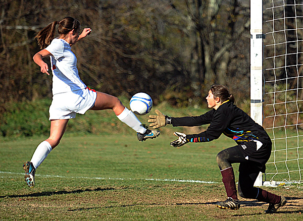 Central High School's Brianna Speed (left) knocks the ball into the net past Orono High School goalkeeper Taylor Gray to score her team's first goal during the Eastern Maine Class C girls soccer championship in Corinth Wednesday. Central won 4-3 after the second round of penalty kicks.