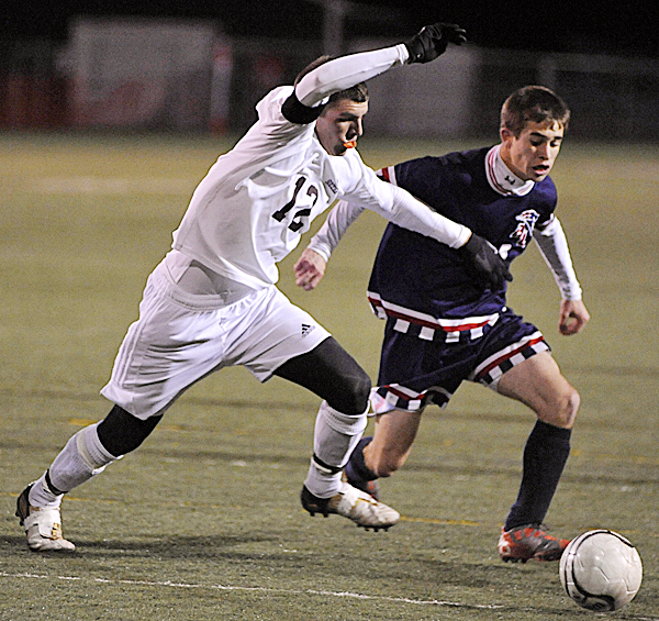 Bangor Christian's Brad Wilcox (right) moves the ball away from a Richmond defender before scoring a goal in last year's state final. Wilcox has tied the state boys' soccer career goal-scoring record entering Saturday's state final against Greenville at Falmouth High School.