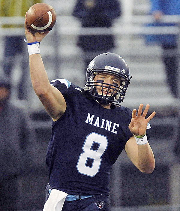 UMaine quarterback Warren Smith throws a pass against Delaware in Orono on Oct. 1.