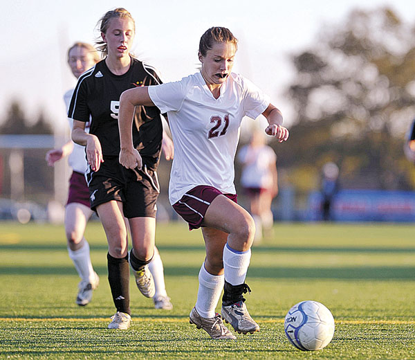 Bangor's Ashley Robinson (21) pushes the ball down the field against Brunswick Wednesday. Robinson will lead the Rams against Scarborough in Saturday's Class A state final in Falmouth.