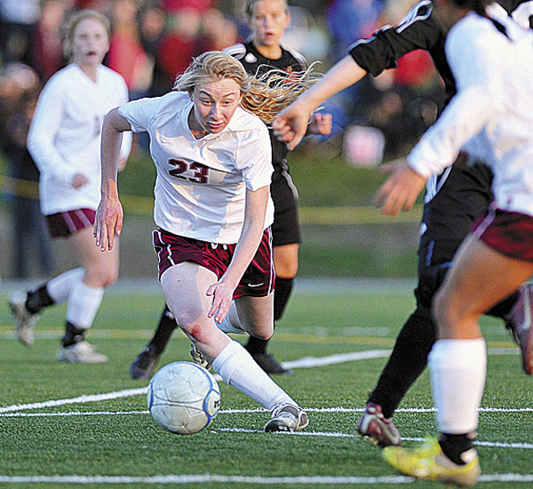 Bangor's Grace Maclean (23) competes against Brunswick in the Eastern Maine Class A final Wednesday. Maclean and the Rams will vie for the Class A title Saturday against Scarborough.
