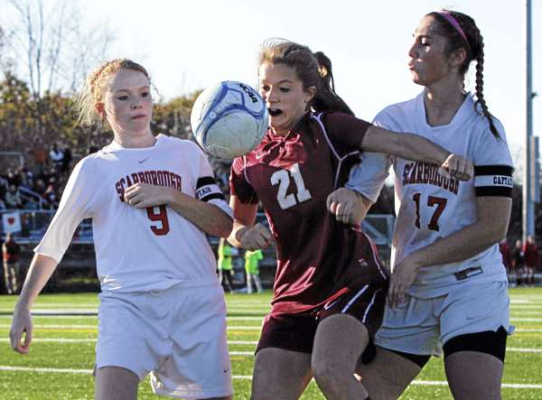 Bangor High School senior striker Ashley Robinson tries to fight her way through Scarborough's Emily Tolman (9) and Jessica Broadhurst (17) during Saturday's state Class A championship soccer game at Falmouth High School. Bangor won its first schoolgirl soccer state championship 4-0.