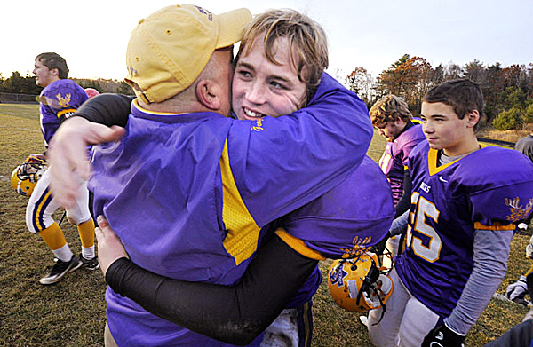 Bucksport High School wide receiver Jon Geagan gets a congratulatory hug from his dad Sean Geagan who is also an assistant coach for the team.  Bucksport defeated Orono 25-14 in their Eastern Maine LTC Class C Championship in Bucksport Saturday afternoon, Nov. 12, 2011. Bucksport will play Yarmouth for the Class C state title Saturday at 2:30 p.m. at Fitzpatrick Stadium.