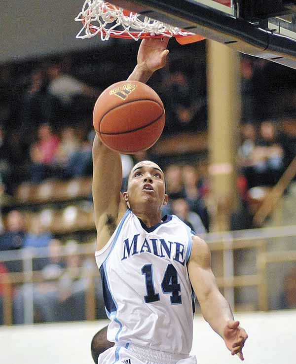 University of Maine's Justin Edwards (14) slams homea dunk in the first half of the Black Bears' men's basketball game Monday against UMaine-Machias in Memorial Gym in Orono. Edwards and the rest of the Black Bears will take on defending national champion Connecticut on Thursday in Hartford, Conn.