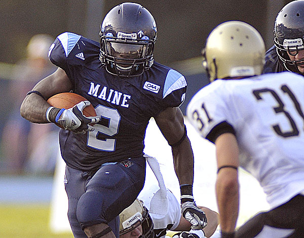 Pushaun Brown carries the ball against Bryant earlier this season in Orono, Maine, Saturday Sept. 3, 2011.