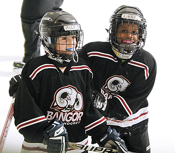 Ally Trimper (left) and Libby Spekhardt are two Bangor Youth Hockey girls who could be candidates to play if one or more Bangor-area high school girls hockey teams are started.