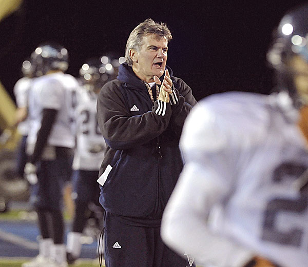 Maine football coach Jack Cosgrove spurs his players on during practice in Orono, Tuesday , Nov. 29, 2011.