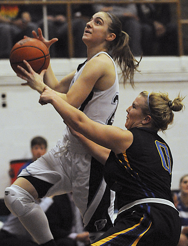 UMaine's Samantha Wheeler is fouled by Maine Maritime Academy's Brittany Gallagher during first-half action on Tuesday night Nov. 29, 2011 at Memorial Gym on the UMaine campus.