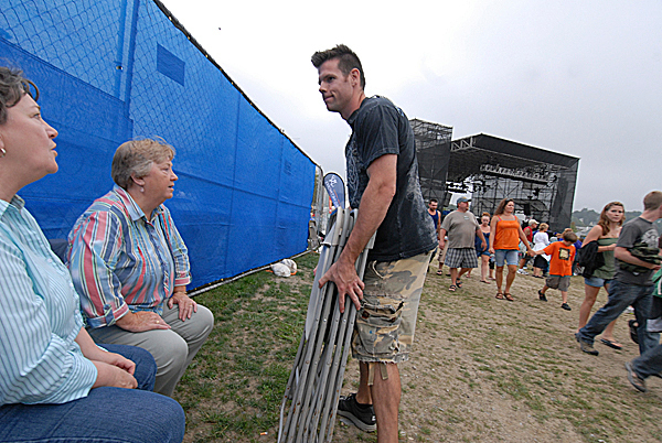 As he helps move seats, Waterfront Concerts promoter Alex Gray, stops to talk with concert-goers before the start of the Charlie Daniels-Lynyrd Skynyrd  show on the Bangor Waterfront in August 2010.