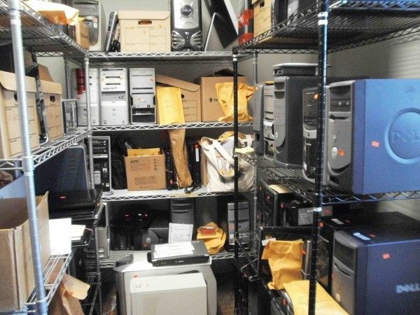 Computers and other electronic devices are stacked to the ceiling in several evidence rooms at the Maine State Police's Computer Crimes Unit in Vassalboro recently. The unit — tasked with investigating child sexual abuse, exploitation and trafficking crimes as well as other computer-based offenses — have had to backlog some pending investigations because there are't enough forensic investigators.
