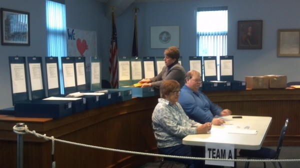 Hampden town clerk Denise Hodsdon opens 14 previously sealed and locked ballot boxes from the town's Nov. 8 election to begin a Monday recount of ballots and votes for the District 2 council race.