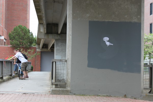 An example of the Pigeon's artwork, attached to a downtown Bangor bridge with wheat paste.