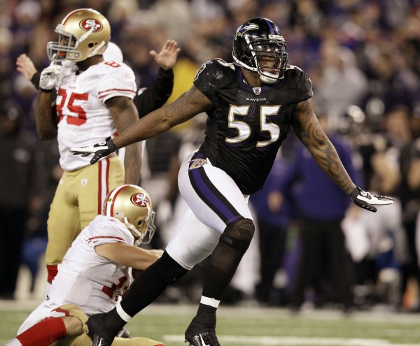 Baltimore Ravens outside linebacker Terrell Suggs (55) reacts after sacking San Francisco 49ers quarterback Alex Smith (bottom left) during the second half of an NFL football game in Baltimore on Thursday, Nov. 24, 2011. Baltimore won 16-6.