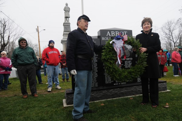 U.S. Sen. Susan Collins and veteran Wayne Bennett, a Sons of Union Veterans member and Civil War historian, lay a memorial wreath at Abbot's newly installed veterans memorial during its dedication Friday.
