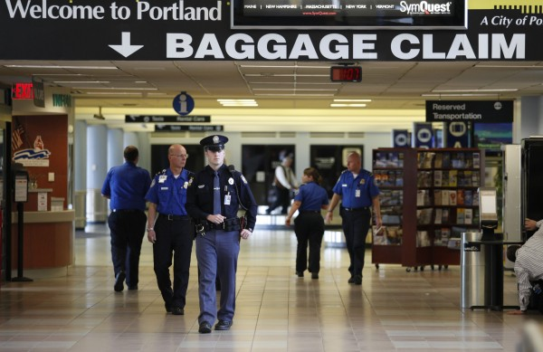 Police and TSA officers evacuate a section of the Portland International Jetport terminal Thursday, April 2, 2009, in Portland, Maine. Security screeners spotted a suspicious object in a carry-on bag prompting the evacuation and four-hour shut down of the airport.
