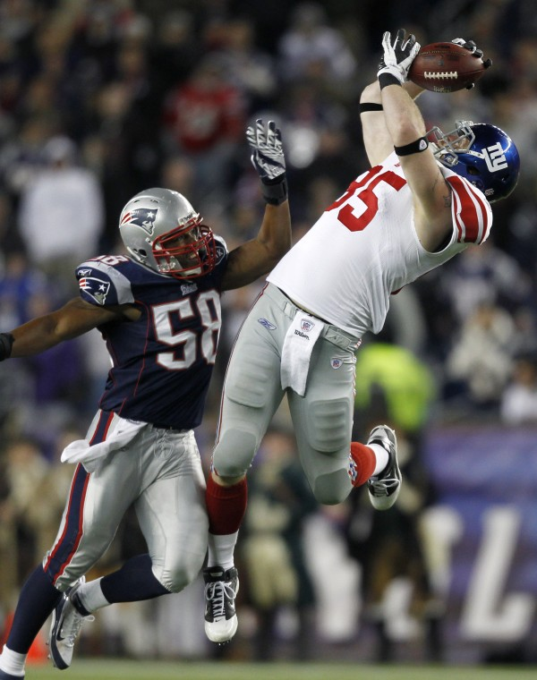 New York Giants tight end Jake Ballard (85) makes the reception in front of New England Patriots linebacker Tracy White (58) in the fourth quarter of an NFL football game in Foxborough, Mass., Sunday. Ballard had a touchdown reception later on the drive as the Giants won 24-20.