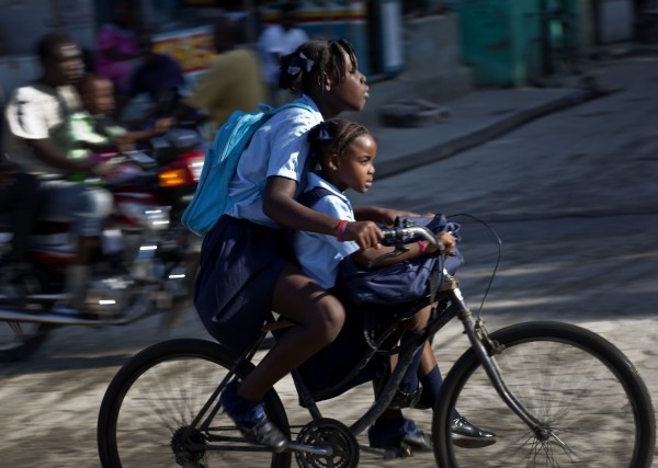Two girls bike to school in Leogane, Haiti on Tuesday Nov. 8, 2011.