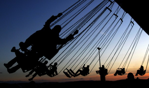 Palestinians enjoy a ride in an amusement park, during Eid al-Adha in the West Bank village of Haddad near Jenin, Monday, Nov. 7, 2011. Muslims worldwide celebrate Eid al-Adha, or the Feast of the Sacrifice, with the sacrificial killing of livestock to commemorate the religious story of Abraham