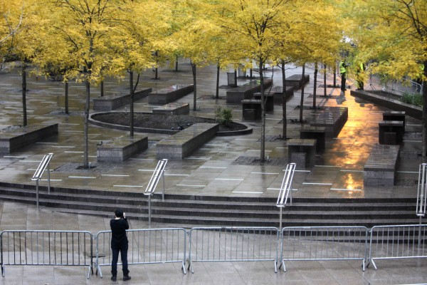 A pedestrian takes a picture of an empty and closed Zuccotti Park in New York on Tuesday, Nov. 15, 2011. Police officers evicted Occupy Wall Street protesters from the park overnight. The National Lawyers Guild obtained a court order allowing the protesters to return with their tents to the park, where they have camped for two months. The guild said the injunction prevents the city from enforcing park rules on the protesters.
