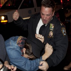 An Occupy Wall Street protester draws contact from a police officer Tuesday morning.