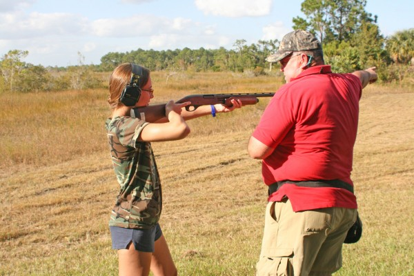 Reporter and fledgling outdoors woman Hannah Sampson gets pointers in a shotgun course from instructor John Weatherholt as part of the Florida Fish and Wildlife Conservation Commission's training course.