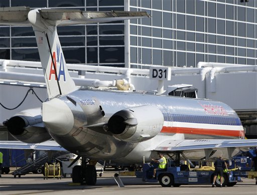In this June 6, 2011 file photo, an American Airlines aircraft at a Terminal D gate at Dallas-Fort Worth International Airport, in Grapevine, Texas. American Airlines and American Eagle's parent companies are filing for Ch. 11 bankruptcy protection Tuesday, Nov. 29, 2011. (AP Photo/Tony Gutierrez, File)
