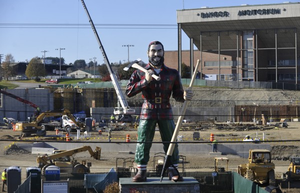 The Paul Bunyan statue and the aging Bangor Auditorium bookend the construction site for the future arena in Bangor Nov. 8, 2011.