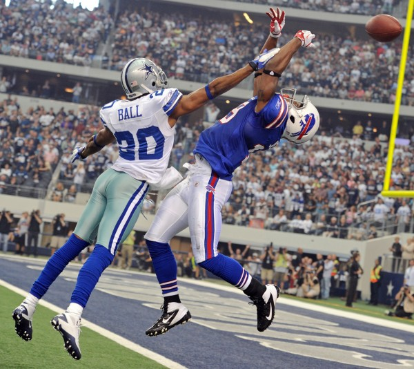 Dallas Cowboys' Alan Ball (20) knocks a pass out of the hands of Buffalo Bills' Donald Jones on a fourth-down play in the third quarter Sunday, Nov. 13, 2011, in Arlington, Texas.