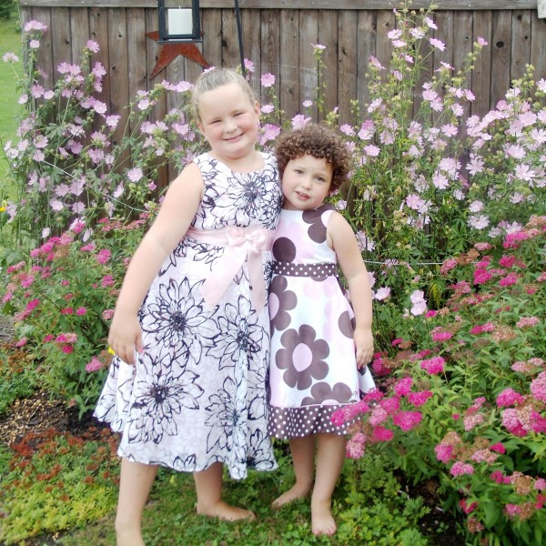 Bobbi Guerrette (right) poses with her older sister Carly this past summer in Mars Hill.