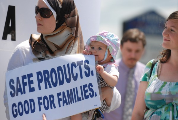 Seven-month-old Noorah Abdelmageed of Bangor chews on the corner of a sign held by her mother; Heather van Frankenhuyzen, owner of the Bella Luna women's clothing shop in downtown Bangor, during a 2009 protest on Union Street in Bangor of businesses selling products containing bisphenol-A, or BPA.
