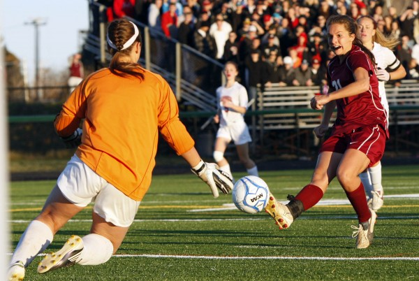 Bangor's Ashley Robinson, right, shoots on Scarborough's Katie Mader in the  Class A soccer state championship in Falmouth Saturday, Nov. 5, 2011.