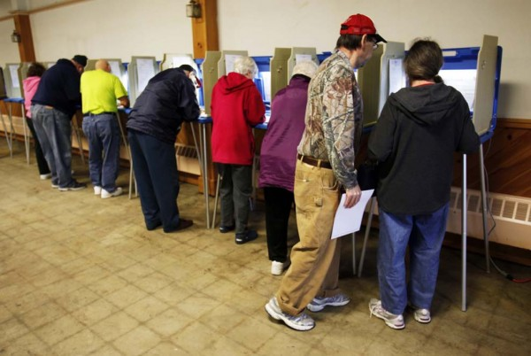 Citizens fill most of the voting booths at the Knights of Columbus Hall in Biddeford.