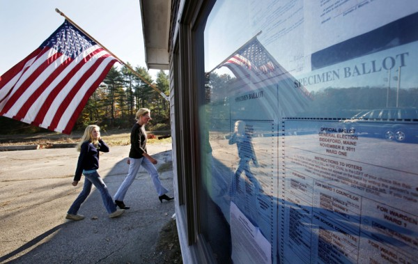Examples of the ballot are displayed on a window at the entrance of the polling place for Wards 1 and 2 at the Knights of Columbus Hall in Biddeford.