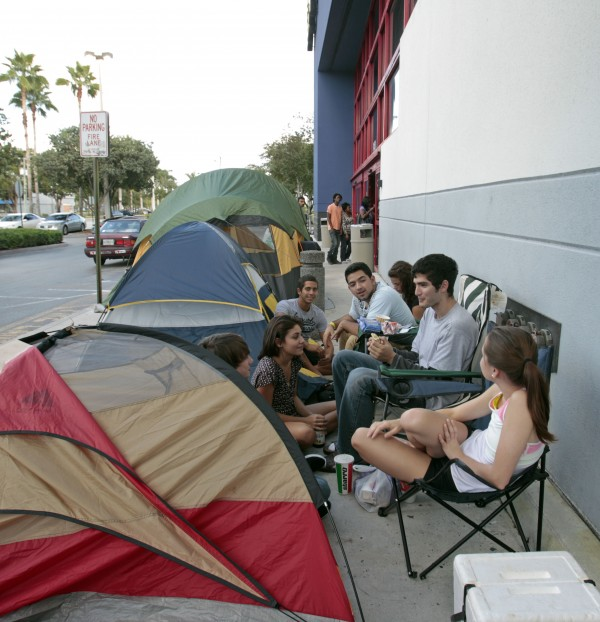 Shoppers camp out at Best Buy for Black Friday in Pembroke Pines, Fla., Wednesday, Nov. 23, 2011. This weekend many stores will for the first time use midnight openings along with the usual bevy of deals as they try to lure consumers, whose appetite for good buys has been increasing since the Great Recession.