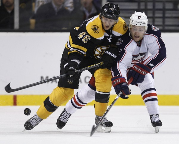 Boston Bruins center David Krejci, left, and Columbus Blue Jackets center Mark Letestu chase the puck during the second period of an NHL game in Boston, Thursday night, Nov. 17, 2011.