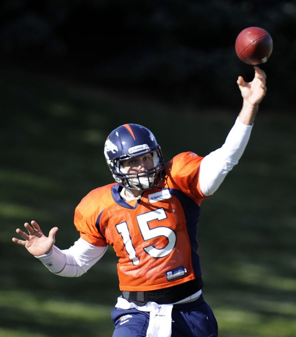 Denver Broncos quarterback Tim Tebow (15) throws a pass during practice, Wednesday, Nov. 9, 2011, at Dove Valley in Englewood, Colo.