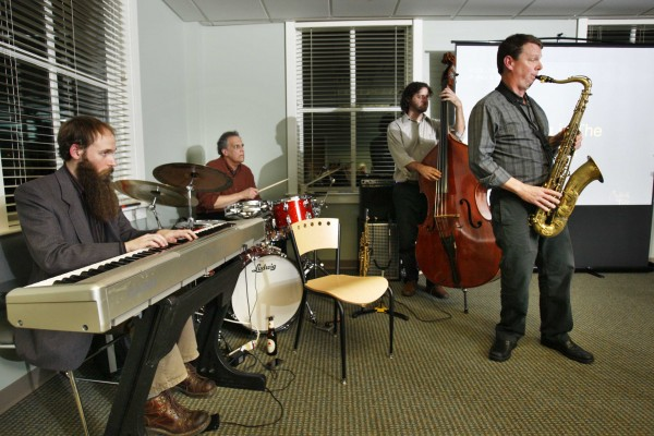 Saxisphonist Matt Langley (right) leads his quartet featuring Mike Effenberger on keyboard, Frank Laurino on drums, and Steve Roy on bass, during a business seminar in Portland.
