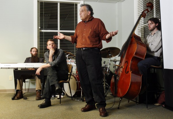 Drummer Frank Laurino, creative director and principal strategist with Backbeat, speaks at a business seminar that used a live jazz quartet as a model for implementing and enhancing business performance.