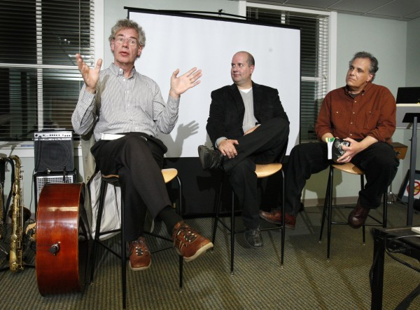 Bill Bruford (left), famed British drummer noted for his work with Yes, King Crimson and his own long-running jazz group, Earthworks, speaks at a business and jazz seminar in Portland. John Rogers (center), director of VTEC, and Frank Laurino, creative director and principal strategist with Backbeat, look on.