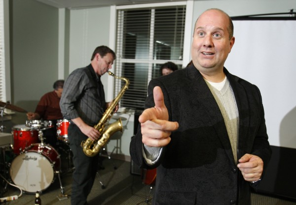John Rogers, director of VTEC, uses a live jazz quartet as a model for implementing and enhancing business performance, during a seminar in Portland.