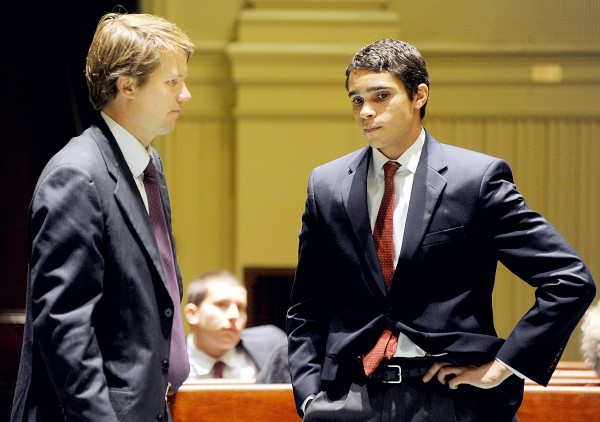 Francis Suozzo (right) speaks with attorney Mike Whipple in Androscoggin County Superior Court on Tuesday.