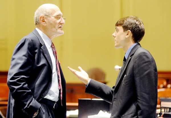 Samuel Guilford (right) speaks to attorney Leonard Sharon in Androscoggin County Superior Court on Tuesday.