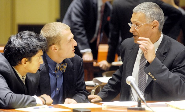 Kush Mahan (from left) and Mark Stehlik listen to attorney Bill Cote in Androscoggin County Superior Court on Tuesday.